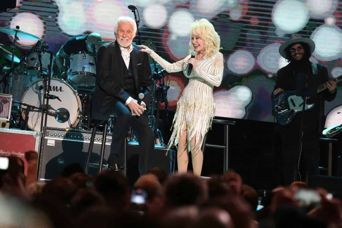 """Kenny Rogers, left, and Dolly Parton share a few stories at """"All In For The Gambler: Kenny Rogers´ Farewell Concert Celebration"""" at Bridgestone Arena on Wednesday, Oct. 25, 2017, in Nashville"""